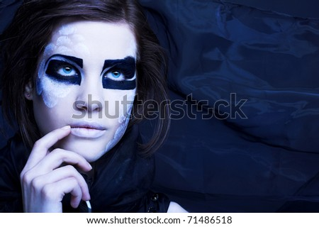 Young woman in black scarf with original  creative make-up