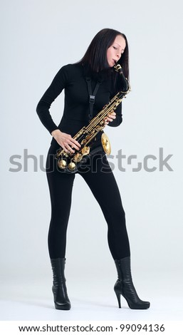 young woman in black with saxophone.