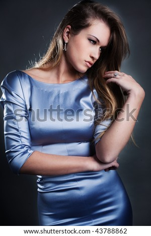 young woman in blue dress