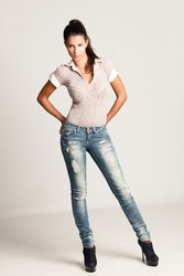 young woman in blue jeans, full body shot, studio, small amount of grain added