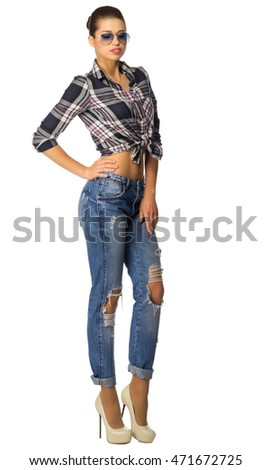 Young woman in blue jeans isolated #471672725