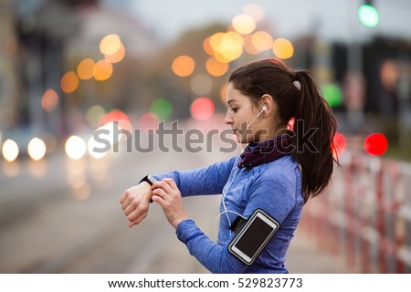 Young woman in blue sweatshirt running in the city #529823773