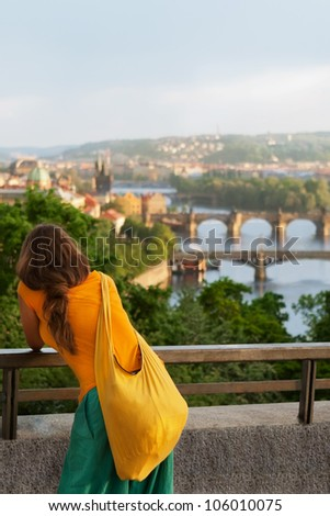 Young woman in bright Indian style clothes travel in Europe/Beautiful city/Prague