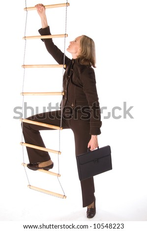 Young woman in brown suit climbing the career ladder isolated on white