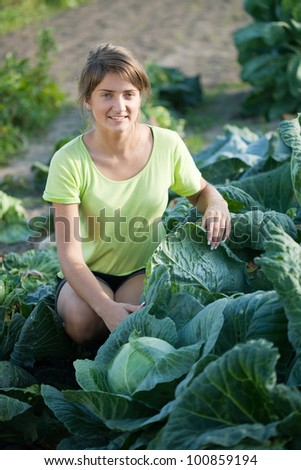 Young woman  in  brussels sprouts plant