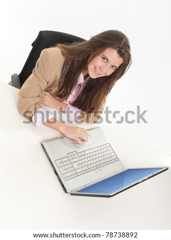 Young woman in business attire sitting at her desk, aerial view