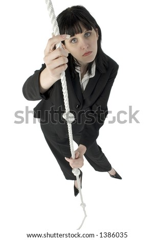 Young woman in business suit grasping a rope. Hopless expression.  Full body.