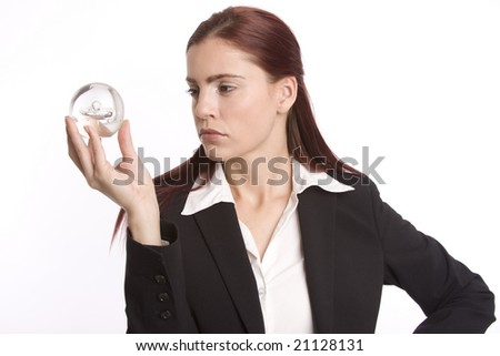Young woman in business suit holding crystal ball in her hand
