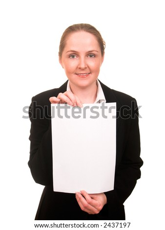 Young woman in business suit showing a sheet of paper in front of her smiling isolated on white