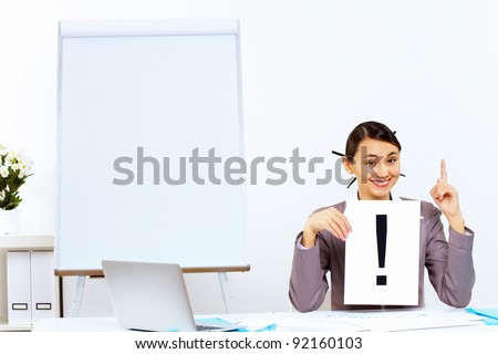 Young woman in business wear generating ideas in office