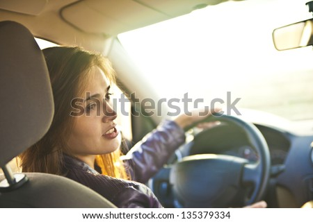 young woman in car - indoor keeps wheel turning around looking at passengers sitting side idea of  taxi driver talking to policeman companion companion who asks for directions right  drive Documents