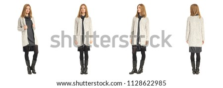 Young woman in cardigan and boots isolated