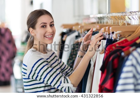 Young woman in clothing store