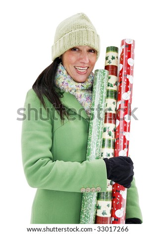 young woman in coat and hat with christmas wrapping paper with clipping path