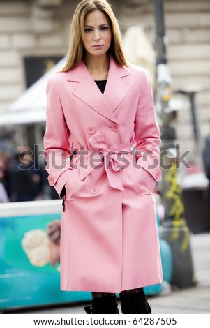 young woman in coat, street shot