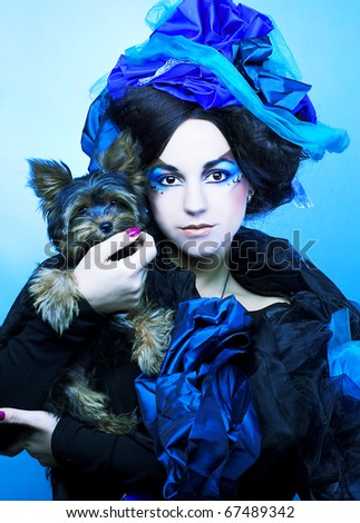 Young woman in creative image and with little dog.