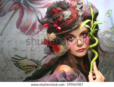 Stock Photo Young woman in creative image wint bamboo