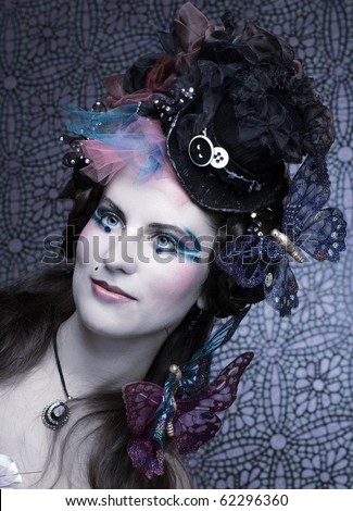 Young woman in creative image with decorative butterflys