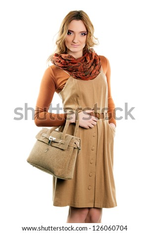 Young woman in dress with a handbag. Isolated