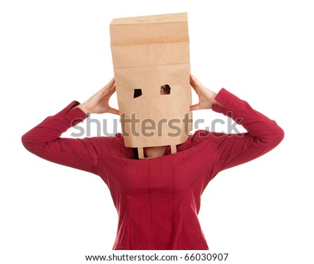 young woman in ecological paper bag on head