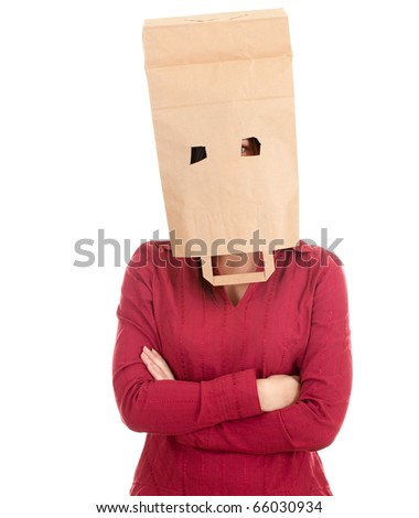young woman in ecological paper bag on head and crossed arms