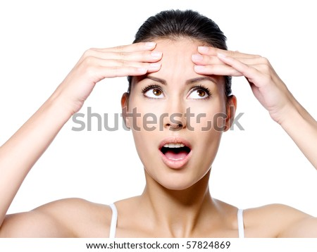 Young woman in expressive emotion of horror because of crease on forehead
