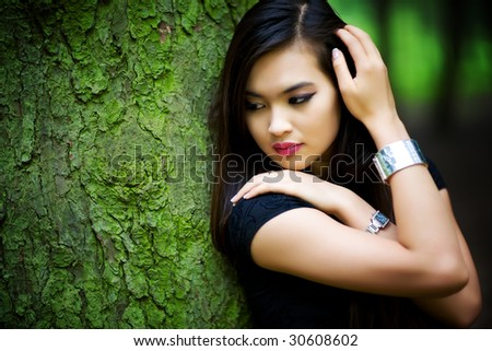 Young woman in forest portrait. Shallow dof.