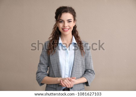 Young woman in formal clothes on color background #1081627103