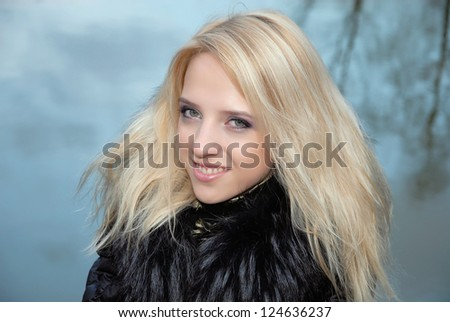 Young woman in fur coat