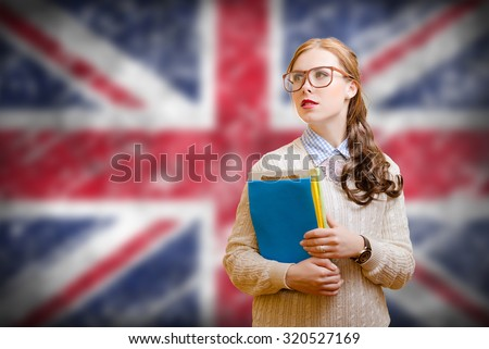 Young woman in glasses holding files on english flag background
