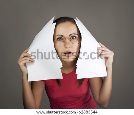 Young woman in glasses holding sheets of paper