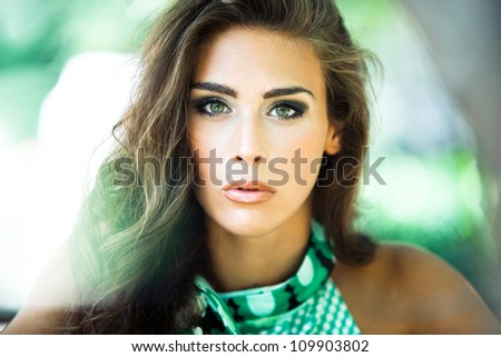 young woman in green dress beauty shot in the wood summer day
