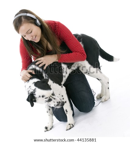 Young woman in headphones relaxing with her lovely dog
