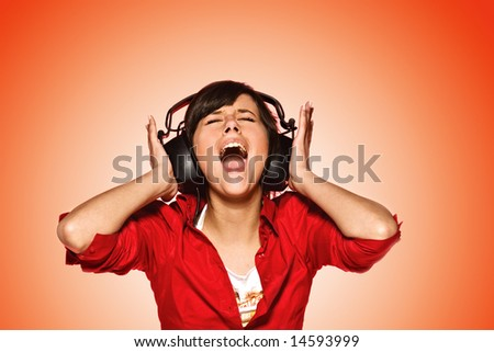 Young woman in headphones singing her favorite song