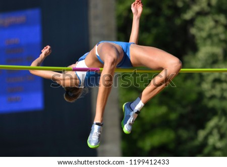 young woman in highjump,track and field