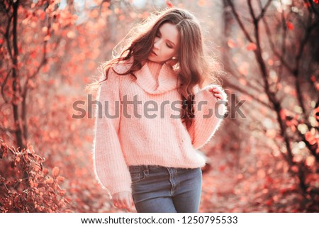 Young woman in Living Coral forest. Color of the year 2019. Main trend natural and authentic concept. #1250795533
