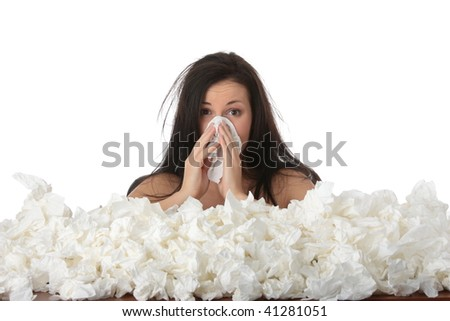 Young woman in lot of tissues around, ill, isolated on white background