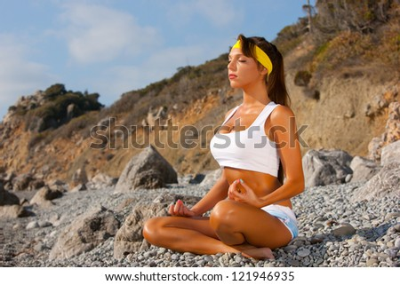 Young woman in lotus pose meditating