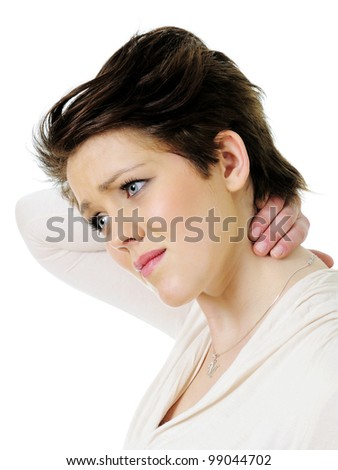 Young woman in pain holding her neck isolated on white