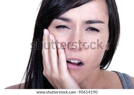 Young woman in pain is having toothache isolated on white