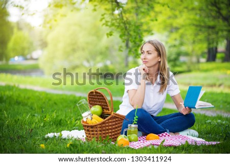 Young woman in park outside at sunny day, enjoying summertime and dreaming #1303411924