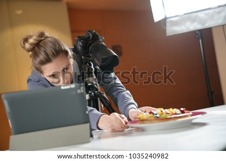 Young woman in photography training class