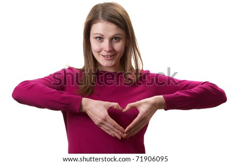 Young woman in purple sweater with heart shape hands isolated over white background