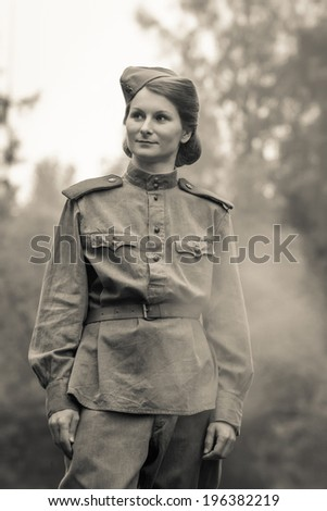 Young woman in Red Army form of 1943 year. Image with film grain effect.