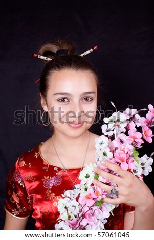 Young woman in red. Chinese styled.