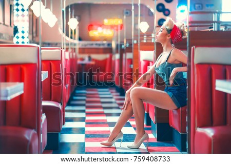 Young woman in retro cafe #759408733