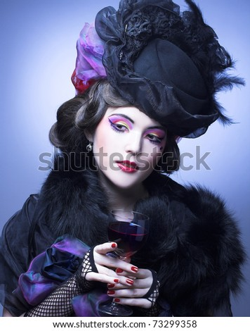 Young woman in retro style with glass of red wine.