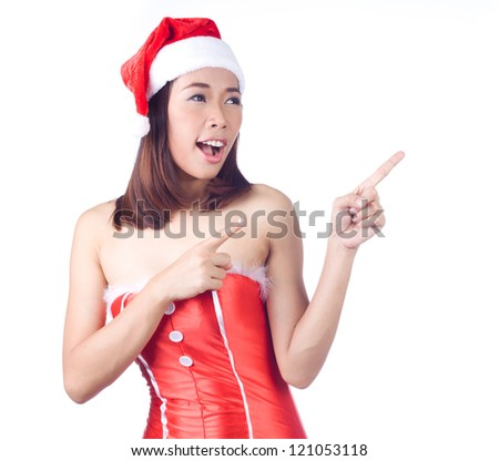 Young woman in santa costume gesturing, showing copyspace for product with open palm on white background