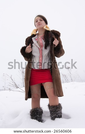 Stock Photo young woman in sheepskin and fur high shoes