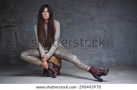 Young woman in shine clothes posing on camera. #290443970